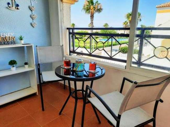 Modern and stylish 2 bedroom apartment with A/C free Wi-Fi and large roof terrace in Gran Alacant with pool views